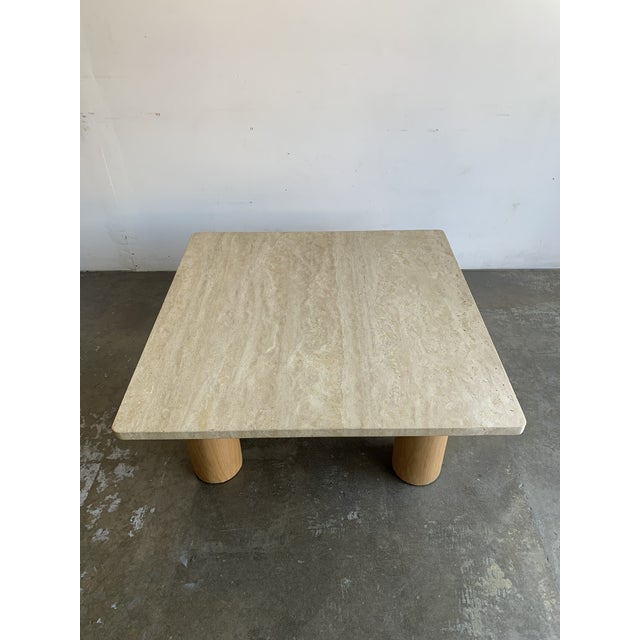 Vintage restored solid travertine top coffee table on four white oak Cyclinder plinth legs. Item offers great stability...