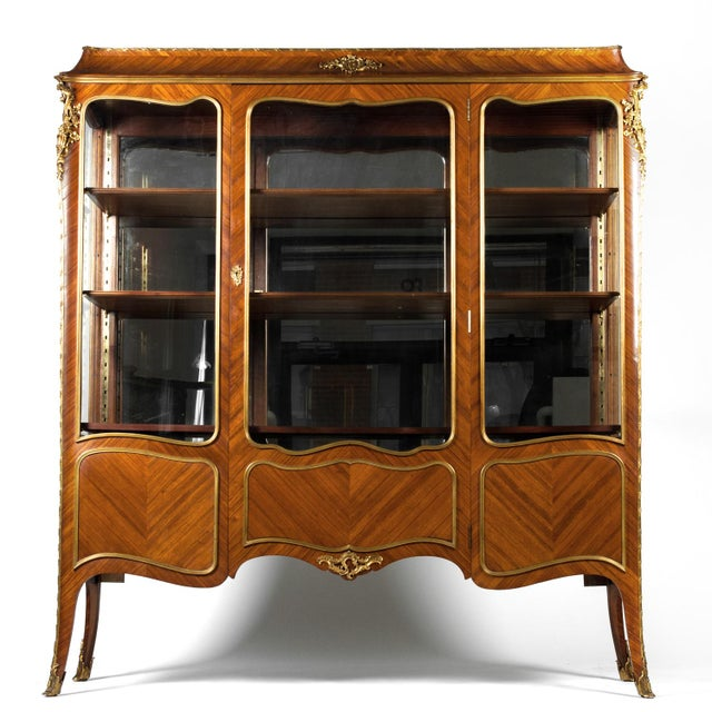 Antique mahogany vitrine with brass accents. Louis XV style with silk velvet interior. All original in excellent...