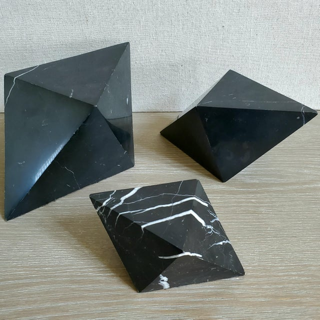 A set of 3 vintage marble geometric octahedrons (a polyhedron with 8 sides) in 3 sizes. The sculptures are diamond shaped...