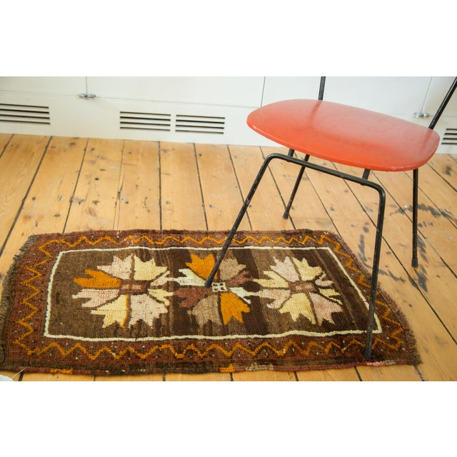 Bold and playful vintage Oushak rug mat with triple floral medallions in a starburst stylization. Main border is zigzag...