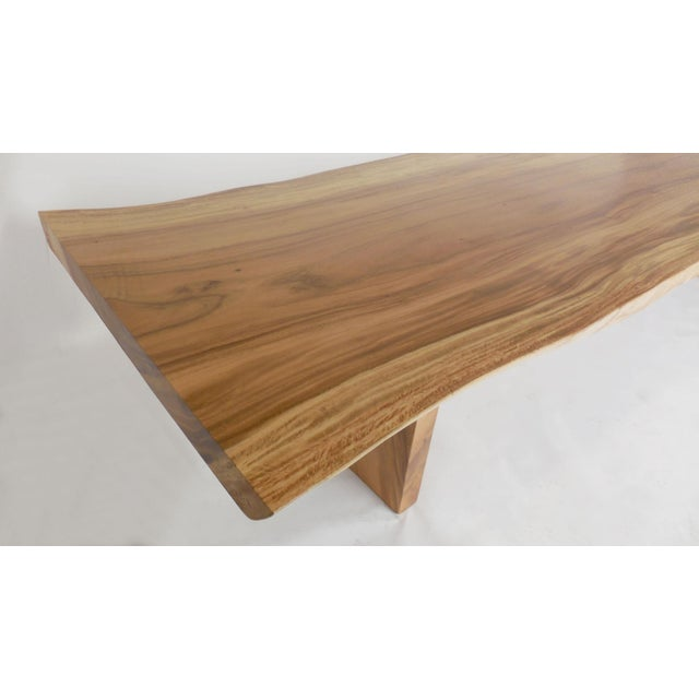 Here is an almost twelve foot beautiful Albezia wood table. The top is a one wide board, sagittally cut and solid top...