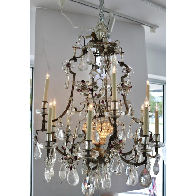 This large-scale, twelve-light Louis XVI style chandelier was created by the iconic firm of Maison Baguès of France. The...