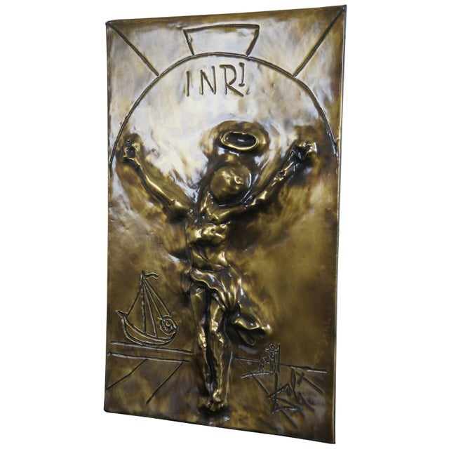 Christ Of St. John Of The Cross, a bas relief sculpture by Salvador Dali with a bronze finish depicting crucifixion image...