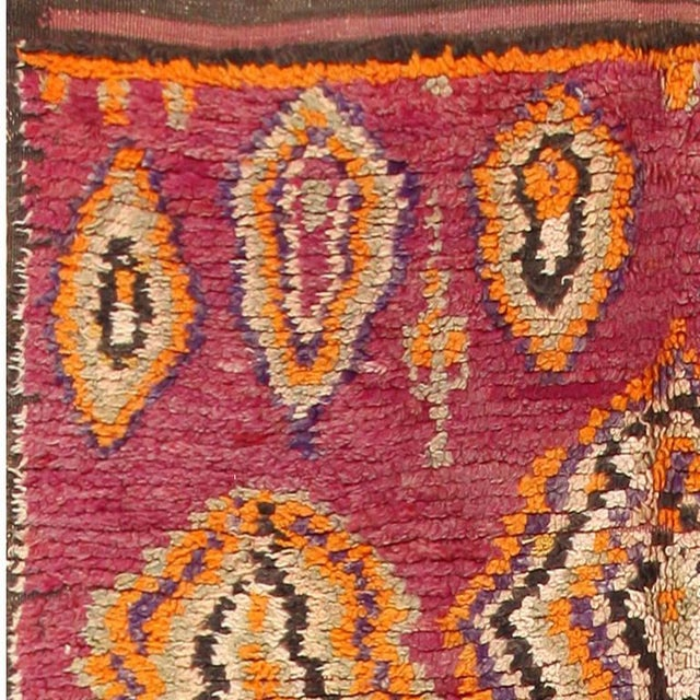 Vintage Moroccan rug, Morocco, mid-20th century. Here is a beautiful vintage Moroccan rug, characterized by a vibrant...
