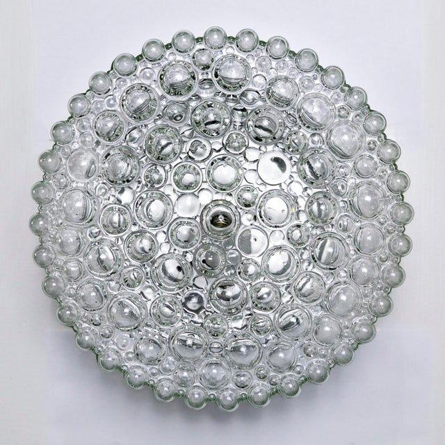 This gorgeous sconce designed by Helena Tynell for Glashütte Limburg has a beautiful design of various sized, crystal...