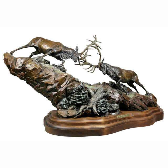 Depicting two Elk locking horns on a wood base. Purchased Jackson Wyoming gallery.