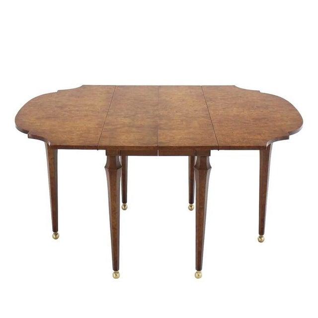Very nice decorative burl drop-leaf dining table. No leafs.