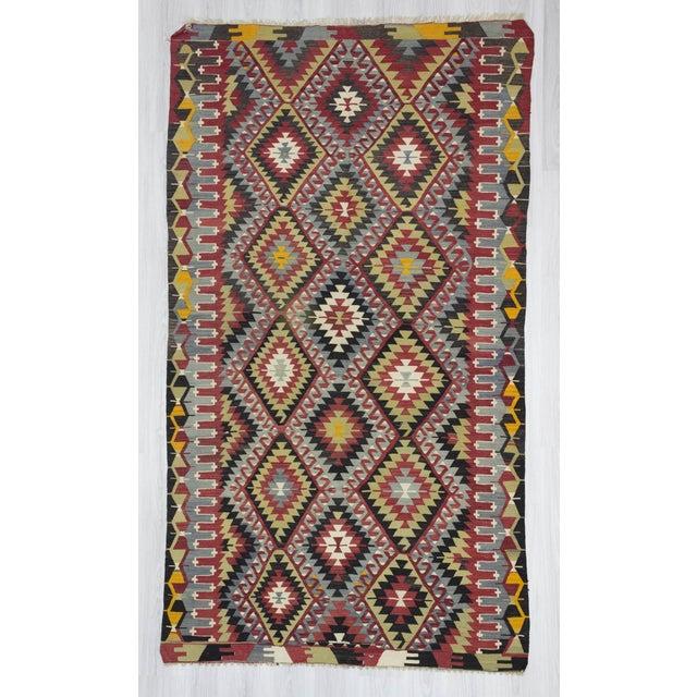 Handwoven vintage decorative colorful Turkish kilim rug from Denizli region of Turkey. In very good condition....