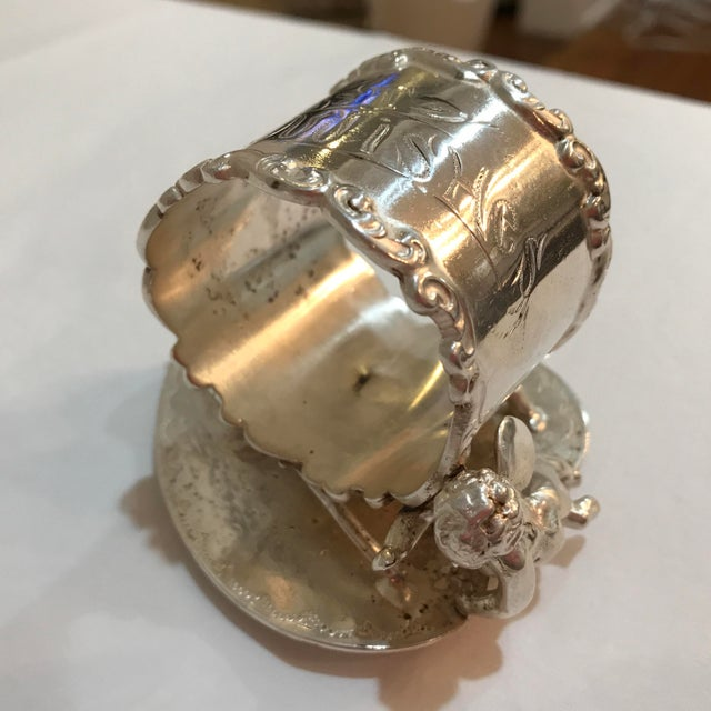 """Delightful Victorian Figural Napkin Ring depicting a """"BEST WISHES"""" message on the top of ring, along with a cherub and..."""