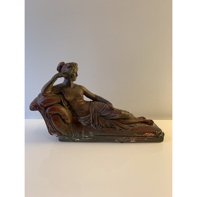 Plaster sculpture of reclining female, Cleopatra possibly. Chips abound lend to the interesting rustic patina.