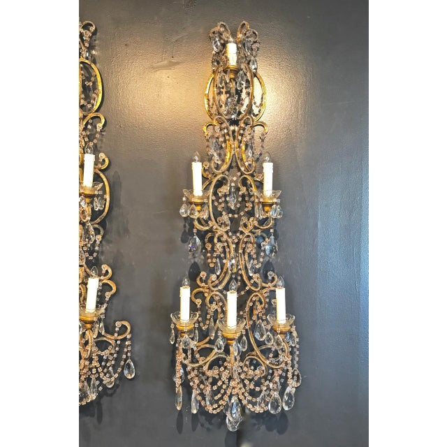 This is a sumptuous pair of large midcentury Italian Beaded Sconces. The sconces measure 48 inches and are detailed with...