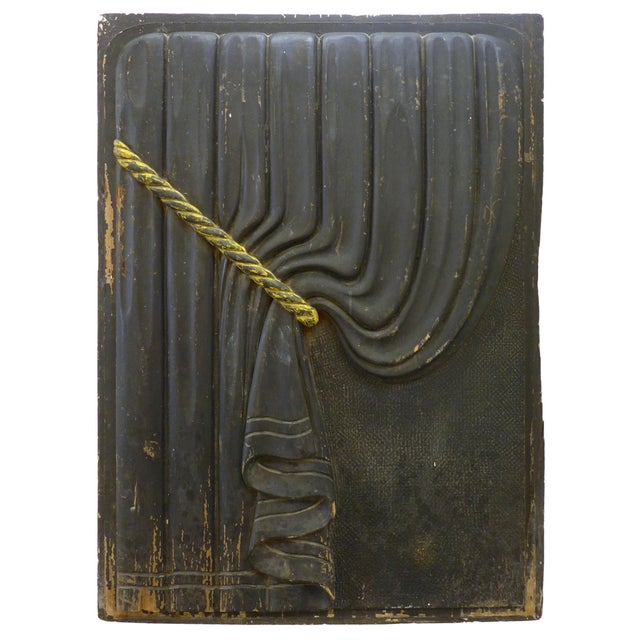 A wonderful pair of early 20th century, carved wood, funeral-coach curtain panels. A mirror-matched pair of matte black,...