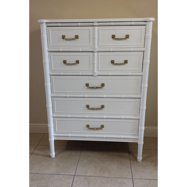 This listing is for a Beautiful Hollywood Regency Faux Bamboo 5 drawers chest. Made by Henry Link, belongs to Bali Hai...