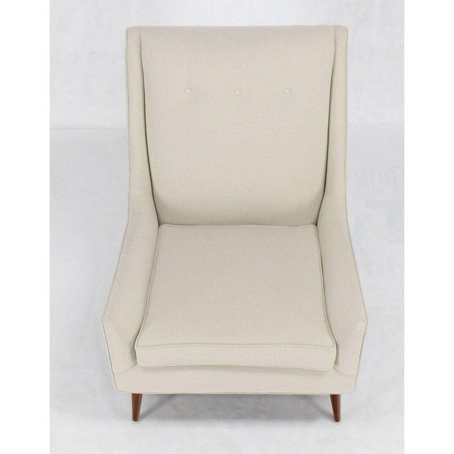 Mid-Century Modern dowel cone legs McCobb lounge chair newly upholstered in linen like fabric.
