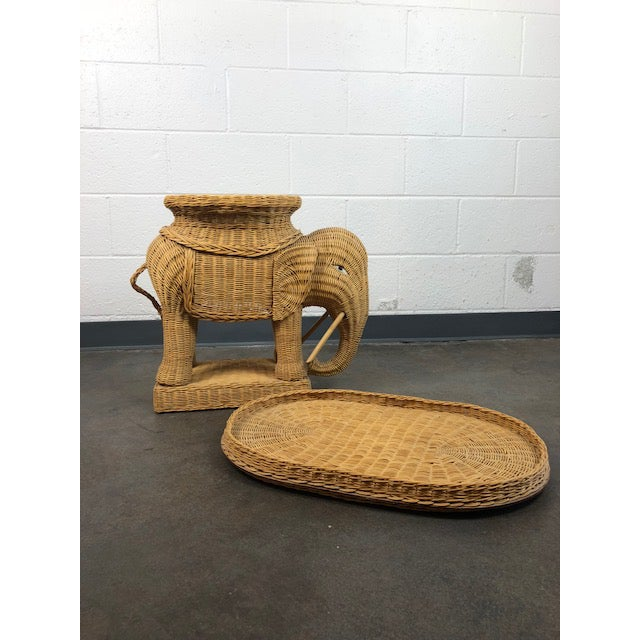 An absolutely stunning woven rattan side table with removable tray top in the shape of an Elephant. This rattan piece is...