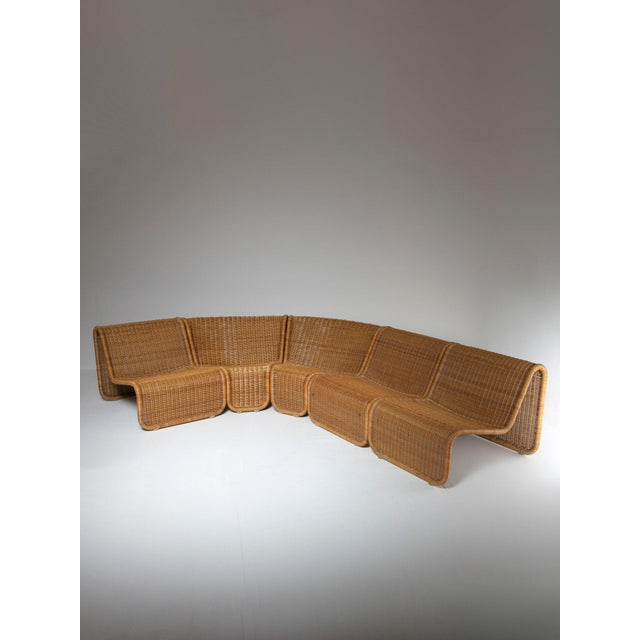 Rare set composed by five seats units and one side table by Tito Agnoli for Bonacina. Early sturdy edition with brass...