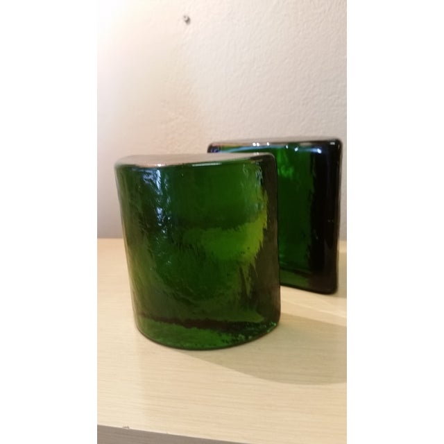 Here's an eye catching pair of Blenko attributed glass bookends from the Mid Century period. These are a deep forest...