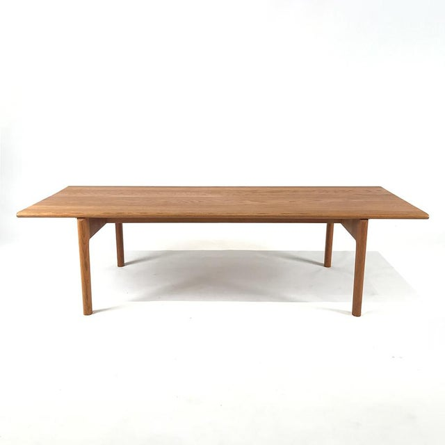 Beautiful solid Oak coffee table features the wonderful design of Hans J. Wegner for Andreas Tuck, model AT-15. Complete...