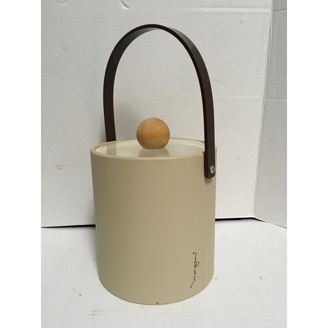 This is a great neutral color ice bucket by Morgan Bucket Brigade. Bucket is tan vinyl with a brown acrylic handle and a...