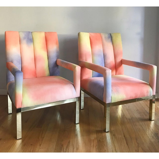Amazing pair of brass based arm chairs circa 1970s. Upholstered in an unreal color-field velvet of pinks, yellow, and...