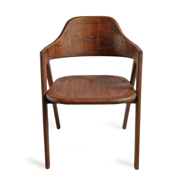 Beautiful elm wood dining chair with arched rounded back and arm rests. Natural wood grain with classic deco design. Newly...