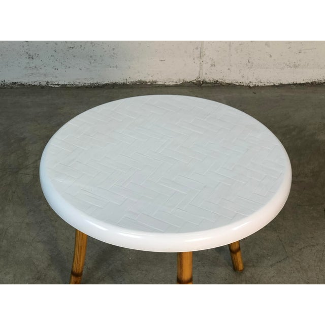 1960s round fiberglass top side table to burnt accented bamboo legs. The top has a basketweave design. Fully restored and...