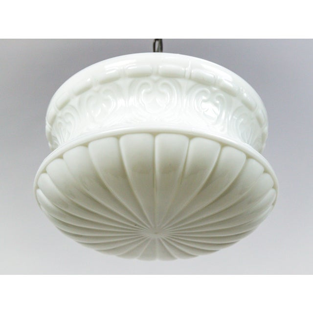 This antique, molded milk glass has a beautiful shape with an acorn and palmette motif. It has been fashioned with a new,...