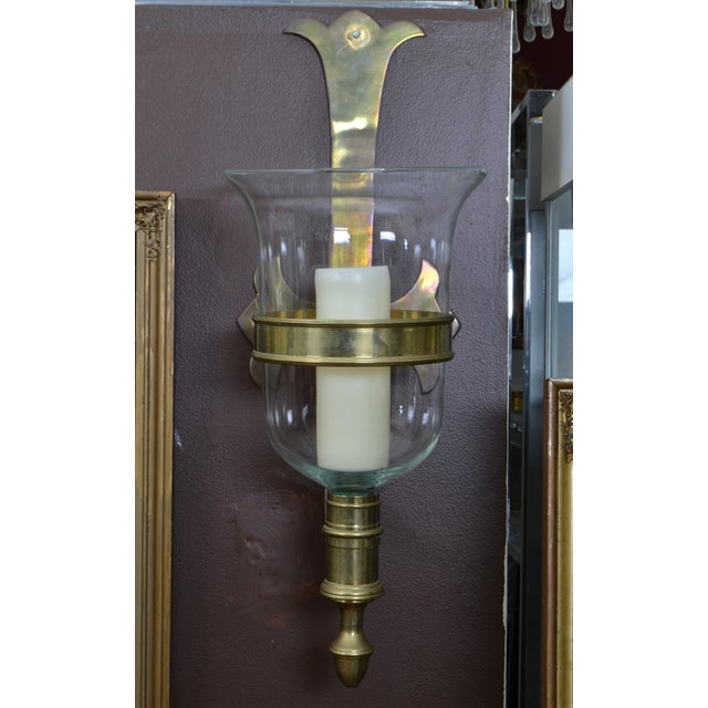 A pair of glass bell hurricane lamps with bronze brackets. Comes with two candles, the set is non-electrified. Can be...