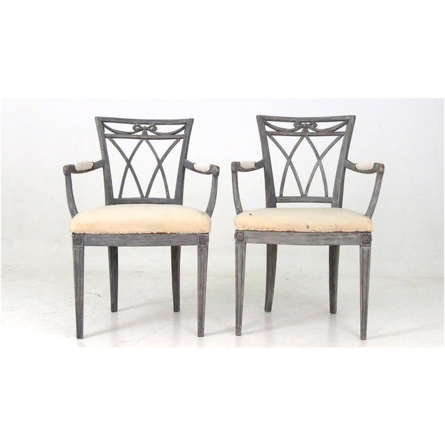 Swedish Carved Arm Chairs with Upholstered seat and arms. C. 1850s.