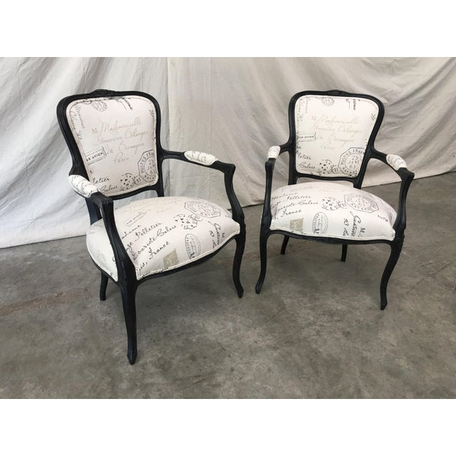 Fabulous pair of French antique Louis XV style arm chairs. This lovely pair features painted walnut frames, which are...
