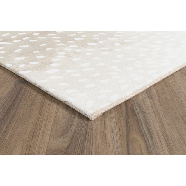 Nessa Sand's lively neutral tones create a smooth, lush tone for any design space. This Stark Studio Rug is meticulously...