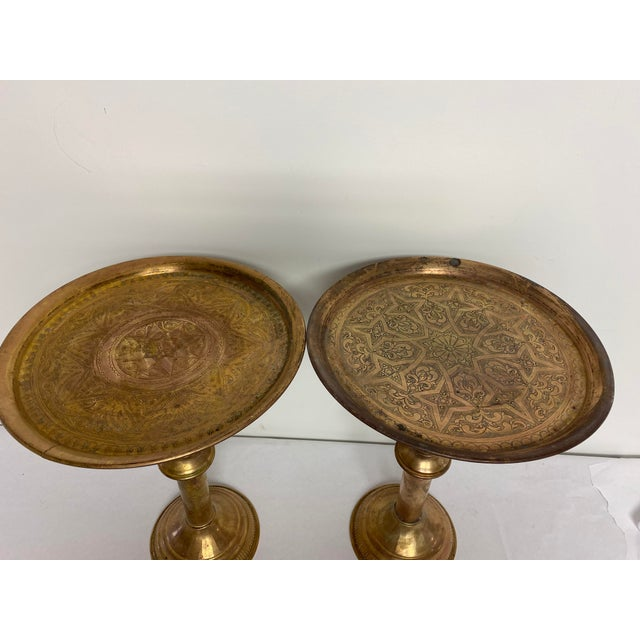 Pair of vintage Egyptian brass engraved pedestal tables. Made in the 1960s.
