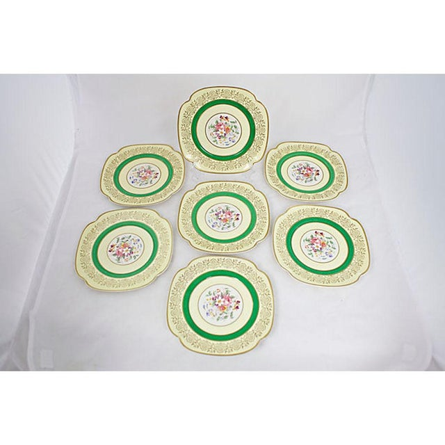 1930's china set with green banding, floral center motif and gold accent detail. Set is 27 pieces total including 7 lunch...