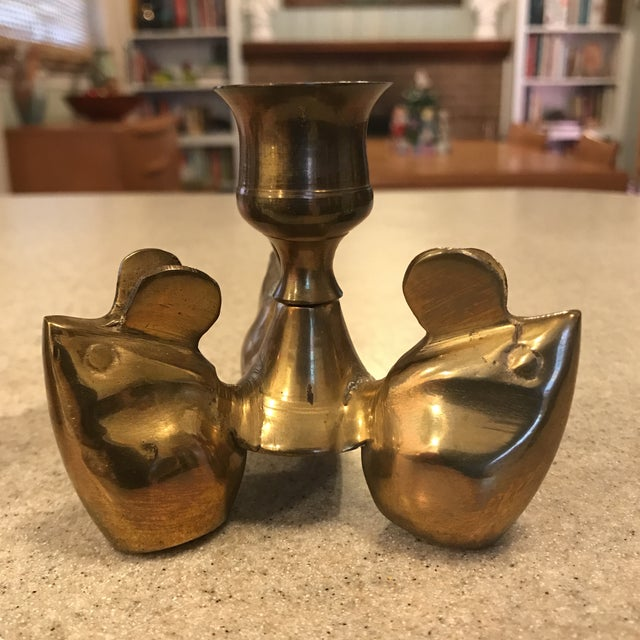 This whimsical pair of candle holders feature 3 mice each. The mice form a tripod that holds the candleholder upright....