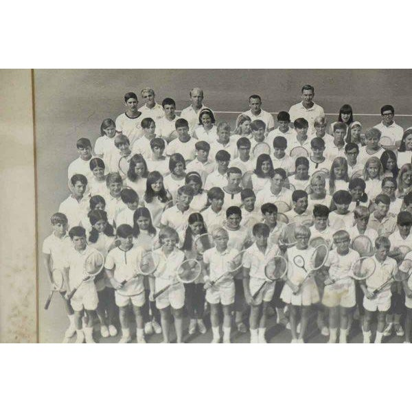 Old framed 1968 black and white photo of a children's tennis camp.