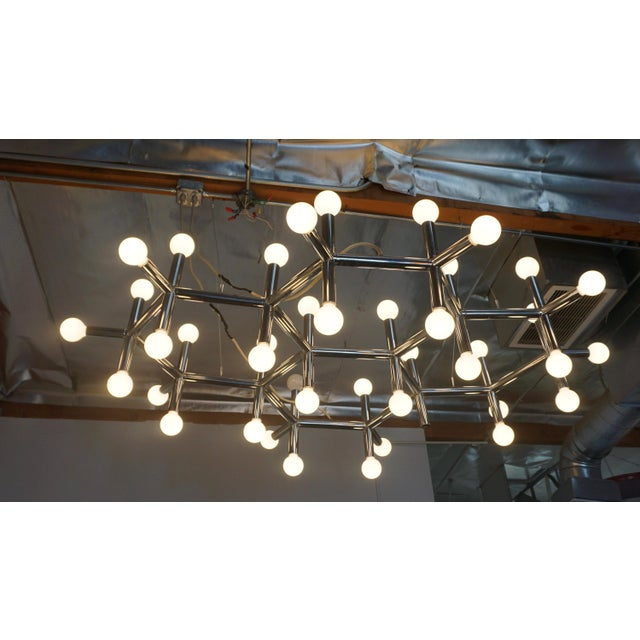 "Molecular structure in chrome plated aluminum mfgd. by Swiss Lamps Intl., designed by Robert Haussmann. Measures 78""L x..."