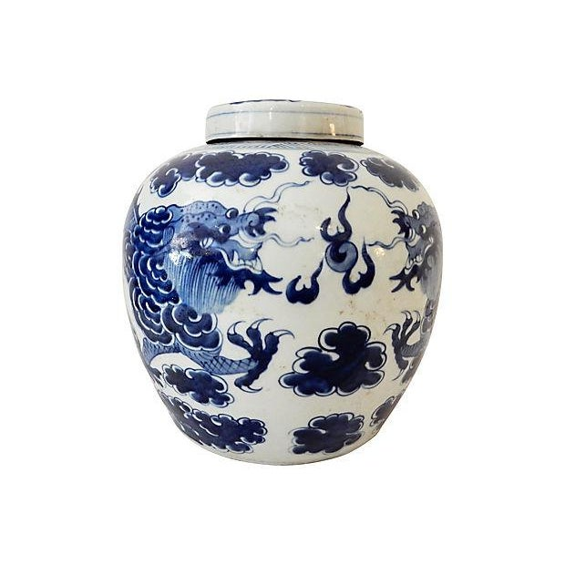 Large blue-and-white covered ginger jar with Dragon motif. Chinese dragons traditionally symbolize potent and auspicious...