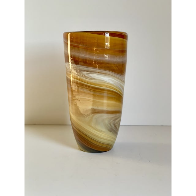 Breathtaking hand blown glass vase in colors of amber, goldenrod, beige, and white. Truly a work of art. Very heavy, not...