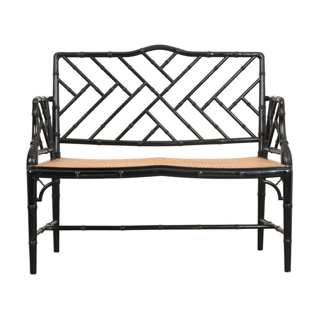 This striking vintage four-piece black-lacquered Chinese Chippendale conservatory suite is from England and consists of a...