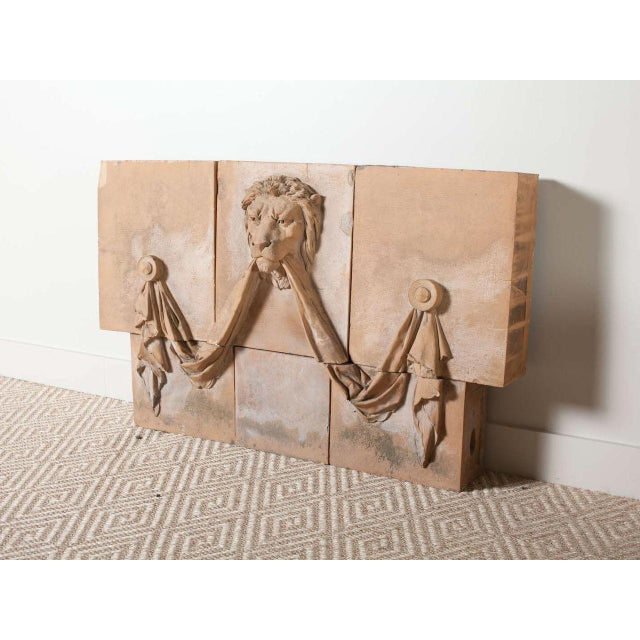 Antique terracotta lion panel. Made from five blocks of terracotta. Fabric and lion details. Pair available, priced...