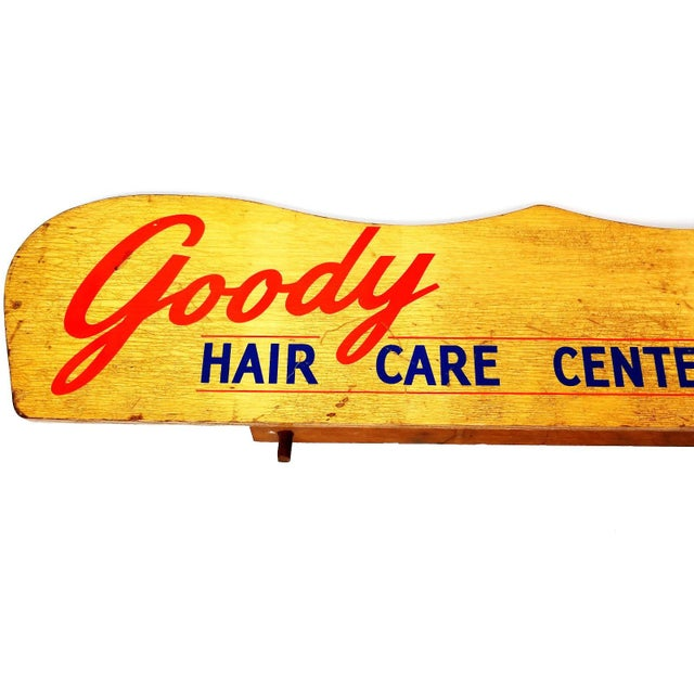 What a great find! This fabulous Goody Hair Care Center wood display sign is perfect for your dressing room, beauty parlor...
