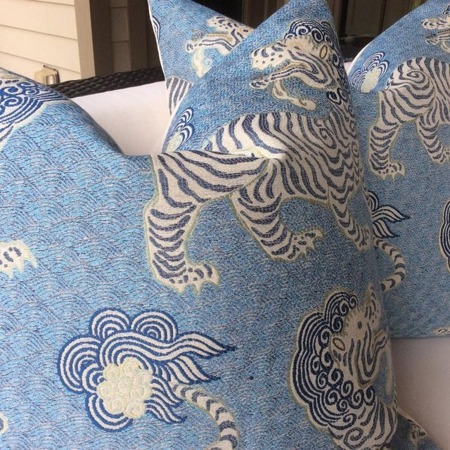 Stunning rich jacquard material featuring Tibetan Dragon tiger in soft blue. Fabric has shades of navy, baby blue, cream...
