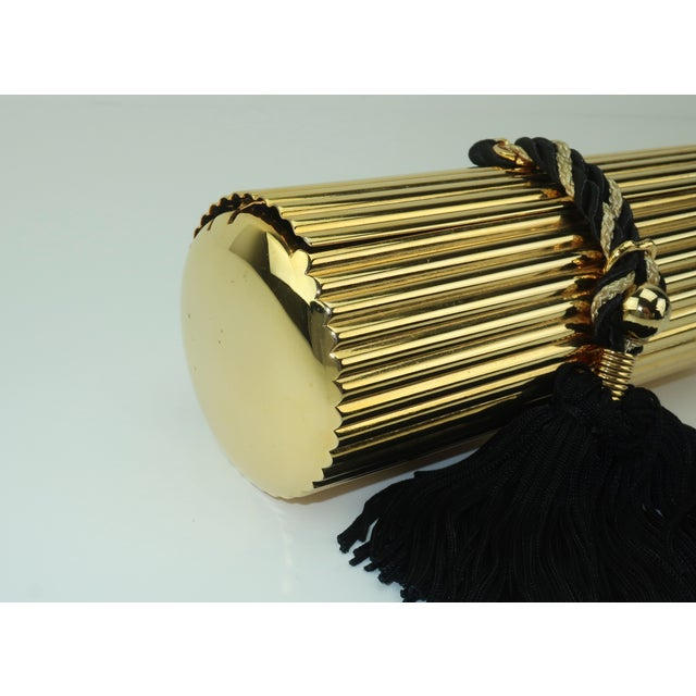 Walborg Gold Metal Cylinder Handbag With Black Tassel Closure For Sale - Image 11 of 13