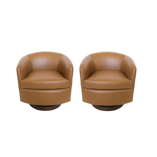 The classic tub chairs with soft, curved design lines designed by Milo Baughman for Thayer Coggin, circa 1960's. The bases...