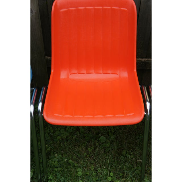 Lot of 10 stacking shell chairs. c. 1970's. Manufactured by Columbia (of the iconic bicycle). Molded polycarbonate seats...