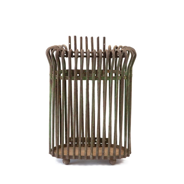 This incredibly sturdy metal rod umbrella holder features a distinctively rich green patina and elegantly curled edges,...