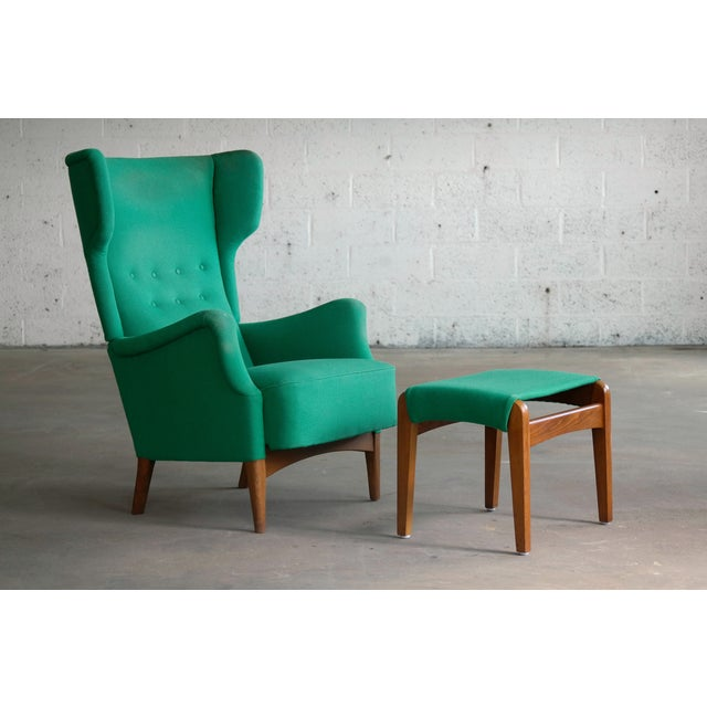 Fantastic modern Danish wingback chair model 8023 designed, circa 1951 and first seen in Fritz Hansen's 1951 catalog. The...