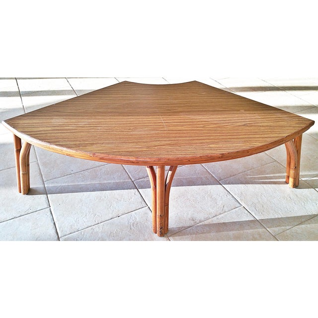 Circa 1970s mica topped and rattan coffee table in the quarter-round. Perfect for a sectional sofa or room corner with...