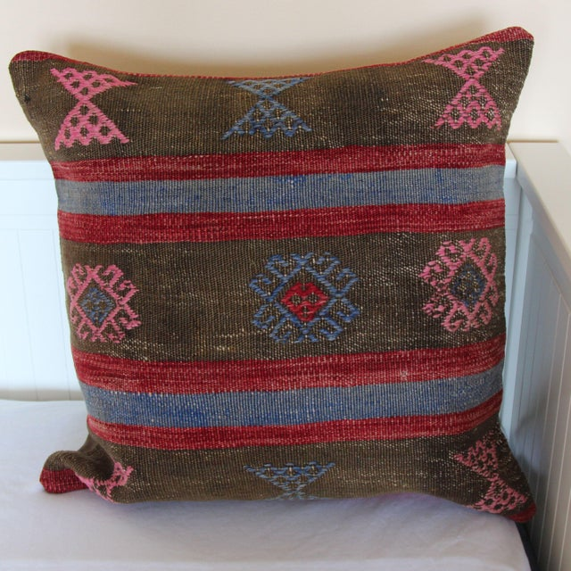 This vintage kilim pillow cover is 20''x 20'' and hand-woven along the Mediterranean coastal region of Turkey. This...