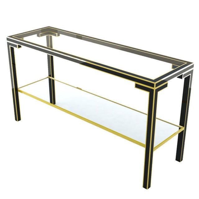 Vintage console table in a mid-century Chinois style in blackened metal with gilded details and glass inserts.